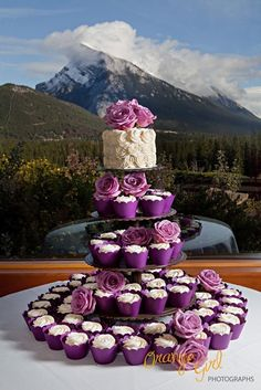 Purple wedding cupcakes with a gorgeous layer of cake on top