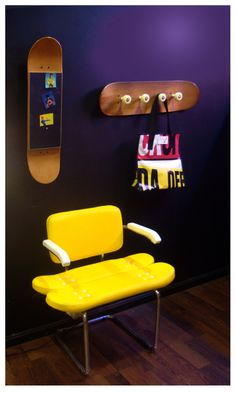 Cool yellow chair, mirror and coat rack furniture design with skateboard ideas. skate wall. Skate Deck Wall Art. Cool gifts, unique gadgets, and awesome toys.