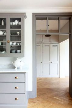 gray kitchen cabinets with metallic pulls. / sfgirlbybay