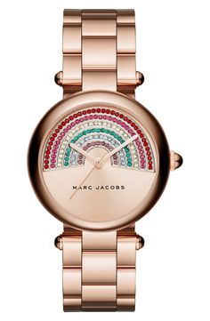 Half sunray, half glistening rainbow, this polished and glamorous bracelet watch by Marc Jacobs keeps the ensemble stylish and fun.