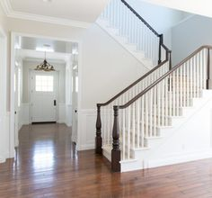 Walls are Benjamin Moore Pale Oak, trim is BM White Shadow, Rejuvenation used on floors to bring them back to life, darker stain on stair railings to create a nice contrast with the lighter walls