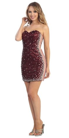 A dazzling short party or cocktail dress embelished with diamond gems