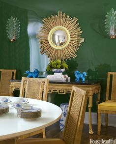 """From the very beginning, my client and I bonded over color,"" says Weiss, who lacquered a luscious green paint, Benjamin Moore's Seaweed, on the dining room walls."