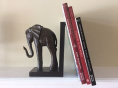 Large Elephant Bookend Book Stop Carved by eyeforaneyevintage