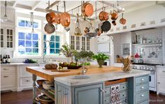 Really liking the look of not so uniform kitchens. They feel more comfy and inviting.