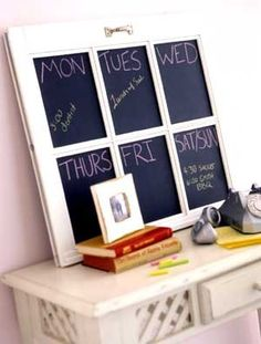 We bought an old window pane this weekend at a flea market hoping to turn it into something...maybe this? I have pieces of chalkboard that I have been meaning to put up for years!