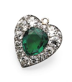 EMERALD AND DIAMOND PENDANT, TIFFANY & CO., CIRCA 1900.  Of heart shape, set with a pear-shaped emerald weighing 5.03 carats, within a frame of 17 old European-cut diamonds weighing approximately 4.00 carats, mounted in platinum and gold, signed Tiffany & Co.