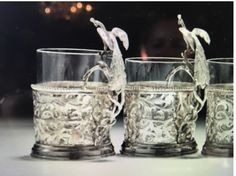 """As described in Chapter Two: """"He reached down to the table and grasped the peacock-shaped handle of the silver filigree zarf that encased the tea glass. Glass Holders, Silver Filigree, Cage, Peacock, Handle, Tea, Peacocks, Cup Holders, Teas"""