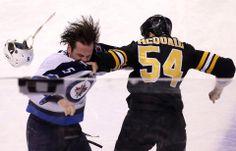 Boston Bruins defenseman Adam McQuaid and Winnipeg Jets defenseman Mark Stuart duked it out in the third period at TD Garden.