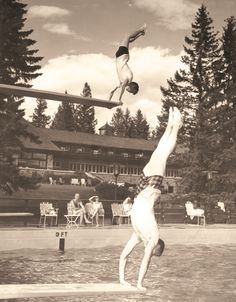 Vintage photo: Divers show off at the outdoor swimming pool at Jasper Park Lodge. See the hotel history at http://www.fairmont.com/jasper/hotelhistory/