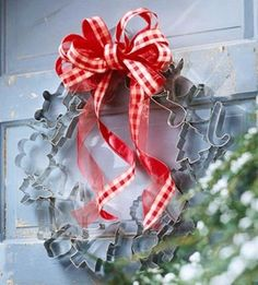 "Cookie Cutter Wreath great for front or side door at cookie exchange. 30 metal cookie cutters, tacky wax, small metal paper clips and 3 yards of 1"" wide ribbon (scissors)."