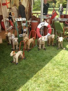 Love these vintage dogs on wheels