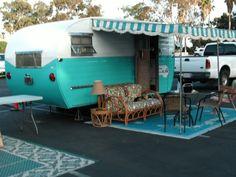 1955 aljoa.---love this one- love the awning and the rug- very homey - looks like they are set up for a long stay....ms