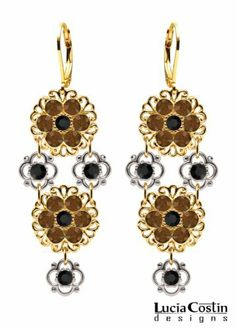 Lever Back Dangle Flower Earrings by Lucia Costin Enriched with Filigree Ornaments, .925 Sterling Silver 4 Petal Flowers, Brown and Black Swarovski Crystal Accents; 14K Yellow Gold over .925 Sterling Silver Lucia Costin. $90.00. Unique jewelry handmade in USA. Floral chandelier earrings amazingly designed by Lucia Costin. Adorned with brown and black Swarovski crystals. Dangle ornaments accented with floral design. Update your everyday style with inspiration when wear...