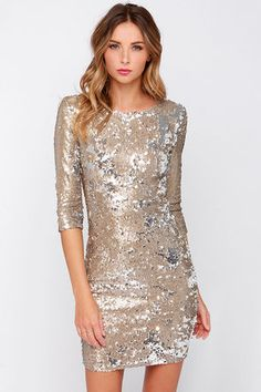 "If you were in the TFNC Paris Gold Sequin Dress, you would say ""Ooo la la, la la la la la!"" How could you not?! Tiny glimmering gold sequins (with silver backs) add sparkling glamour to a sleek, bodycon sheath, with a crew neckline, lightly padded shoulders, and three-quarter length sleeves for a chic structure that lets the sequins take center stage. Exposed silver back zipper. Fully lined. Fabric: 94% Polyester, 6% Elastane. Lining: 97% Viscose, 3% Elastane. Hand Wash Cold. Imported."