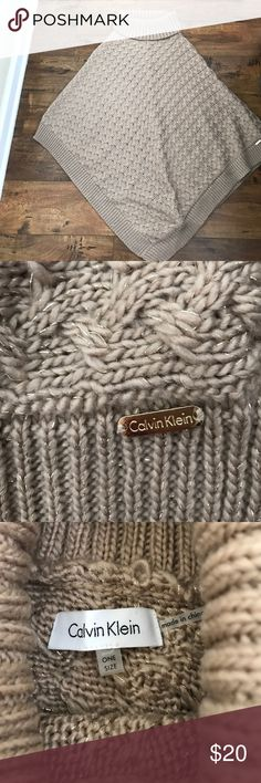 Calvin Klein poncho Tan with gold running through. Cable knit style, very warm and stylish worn only a few times on vacation in NY super cute with jeans or leggings Calvin Klein Sweaters