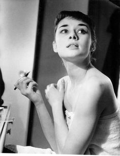 """rareaudreyhepburn:  Audrey Hepburn backstage preparing for her Broadway role in Gigi, c. 1951. Photograph by George Douglas.  [George Douglas] fell """"more than a little in love"""" with Audrey Hepburn when he spent a fortnight photographing her in New York as she prepared for the Broadway production of Gigi and became friends with the novelist Paul Gallico and the actor Peter Sellers."""