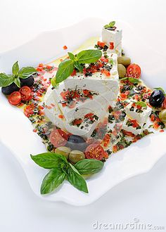 Pieces of feta   with basil and olives, cherry tomatoes
