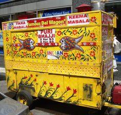 Beautiful Indian decor on NYC street cart selling authentic Indian food such as keema masala, puri bhajji, chicken tikka masala, and dal.