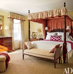 A Robert Kime linen from John Rosselli & Assoc. dresses the window and bed in the master bedroom | archdigest.com