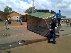This shack destroyed and placed in the middle of the street The Middle, Street, Places, Walkway, Lugares