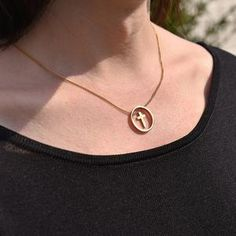 The circle flatters the neckline and includes a floating small gold cross sat within the centre of the circle. Coin Necklace, Star Necklace, Washer Necklace, Pendant Necklace, Fashion Necklace, Fashion Jewelry, Trendy Necklaces, Gold Cross, Jewelry Stores