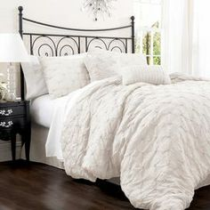 "Offering resort-chic style for your master suite, this feminine comforter set showcases a lovely embroidered motif in ivory.   Product: Queen: 1 Comforter, 1 bed skirt and 2 standard shamsKing: 1 Comforter, 1 bed skirt and 2 king shamsCalifornia King: 1 Comforter, 1 bed skirt and 2 king shams  Construction Material: Cotton-blendColor: IvoryFeatures: Embroidered details14.5"" Bed skirt drop Dimensions: Standard Sham: 20"" x 26"" King Sham: 20"" x 36"" Queen Comforter: 90"" x 92""King Comforter: ..."