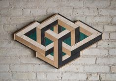 29in. W x 19in. H Handmade wood wall art with reclaimed wood pattern. We can customize sizes of this design in our shop if this one isnt just right for your space. We can Customize the colors, especially the center green color can be any color. This impossible design can be used on above a bed, sofa, or any wall needing some love. Can hung from any side.  Size, color and texture will have small variations due to the nature of reclaimed wood.  Made with raw reclaimed wood.  Can be customized…