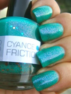 Nerd Lacquer Cyance Friction: a bright cyan with copper shimmer, large and medium copper hexagonal glitter, medium turquoise square glitter, and a gorgeous pink-violet flash. Opaque in two coats and unarguably fabulous.