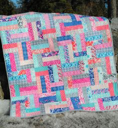 Fun, scrappy jelly roll quilt pattern in five sizes, baby, lap, twin, full/queen and king! Also great for fat quarters and scraps
