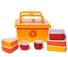 Vintage Tupperware Picnic Set never used complete, 80's sunshine yellow sun outdoor serving camping. $45.00, via Etsy.