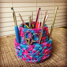 Crochet hook caddy with variegated Red Heart Super Saver Yarn for hooks and scissors and more crafty tools.