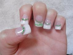 St. Patrick's Day nails. White acrylic tips, green paint art.