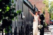 Love the use of the fence with brick building and trees in the background