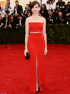 Showing some skin: Anne Hathaway picked striking scarlet and flashed some stomach and leg with a split up the front and cut-out section across the middle