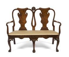 Georgian Walnut Double Chair-Back Settee, Probably Irish - The crest with central carved shell above two scrolled splats with figured walnut veneer & shepherd's crook arms above a slip seat with bowed front with conforming apron on cabriole legs with shell carved knees & ball & claw feet. Length 51 inches