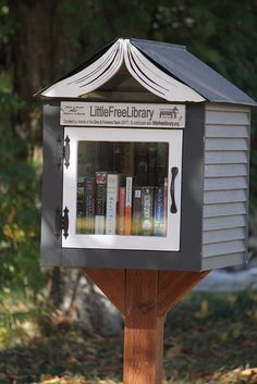 Little Free Library #2410, Spokane, WASHINGTON, as shared on Flickr.com, 25 Oct. 2012. Built by Ben Sahlgren of Seattle from salvaged materials.