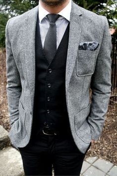 Gray Jacket with Black Vest and Jeans. Love the mixed patterns of the shirt, tie, and pocket square!