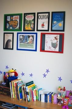 framed book covers:  love this for a library/reading space