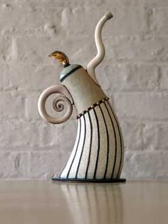 Dancing teapots • Hennie Meyer, Artist, is an acclaimed South African ceramist. He works predominantly in earthenware, creating highly individual pieces