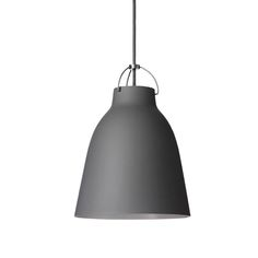 Caravaggio by Fritz Hansen charms with the elegance of dark grey, matt-lacquered shade. Designed by Cecilie Manz, Caravaggio lamp features a deep shade which prevents glare, and an opening at the top, allowing the light to cast also upwards. Black Pendant Light, Contemporary Classic, Fritz Hansen, Caravaggio, Modern Lighting, Lighting Ideas, Bedroom Lighting, Pendant Lighting, Light Fixtures