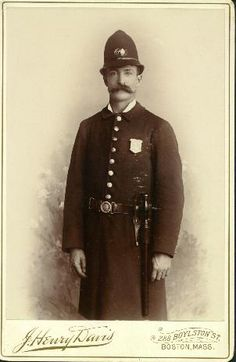 Boston, MA. Cabinet Photo: Officer wearing Radiator badge and baton.
