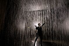 The Rain Room at The Barbican, London. The room is fitted with 3D cameras that sense your location in the room, and automatically turn off the water valves above your head, allowing you to walk through the downpour without getting wet.