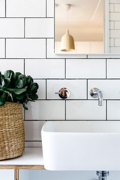 Subway tile with black or dark gray grout for master bathroom -- a great project with a minimal, Scandanavian style.