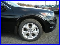 twitter.com/willishonda    From Leftlane News (http://www.leftlanenews.com/honda-accord-crosstour.html) -    The Accord Crosstour EX-L adds or upgrades: leather-trimmed seating surfaces with heated front seats, leather steering wheel, leather gear shift  Nice Honda photo found on the web