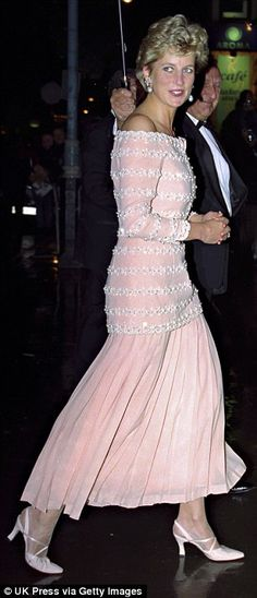 A Catherine Walker dress, embellished with beads and mock pearls was worn by Diana in 1993, to the Savoy Theatre in London.