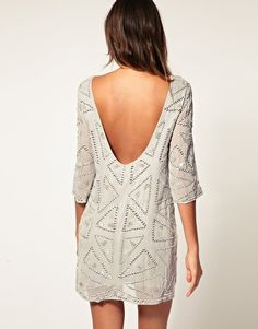 i love the open back and short hem balanced by the sleeves. and the sharp, geometric pattern is made feminine with beads and sequins. perfect.