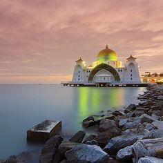 Malaysia's Malacca Straits Mosque sits along the Malacca Straits and is the most beautiful at night when you can see the lights reflecting off the water. Wouldn't you love to visit?