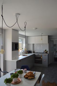 IKEA grey and white kitchen with copper hardware