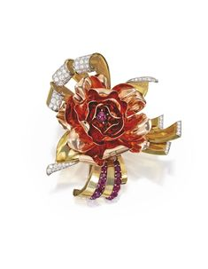 PLATINUM, TWO-COLOR GOLD, DIAMOND AND RUBY BROOCH, TRABERT & HOEFFER MAUBOUSSIN, CIRCA 1940. The stylized flowerhead centered by a cabochon ruby within a border of gold curling ribbons, rays and stylized leaves, accented by 14 round rubies, further set with numerous old European-cut diamonds weighing approximately 2.50 carats, mounted in pink and yellow gold, signed Trabert & Hoeffer Mauboussin.